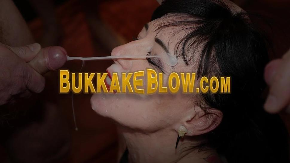 Horny slut sucking dicks during blowbang