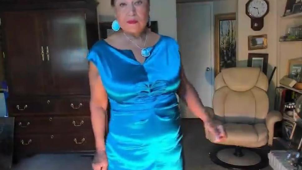 mature Latine woman dancing striptease & masturbating