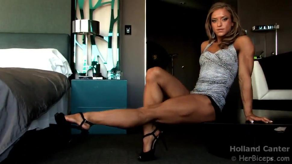 Muscle girl flexing legs and biceps