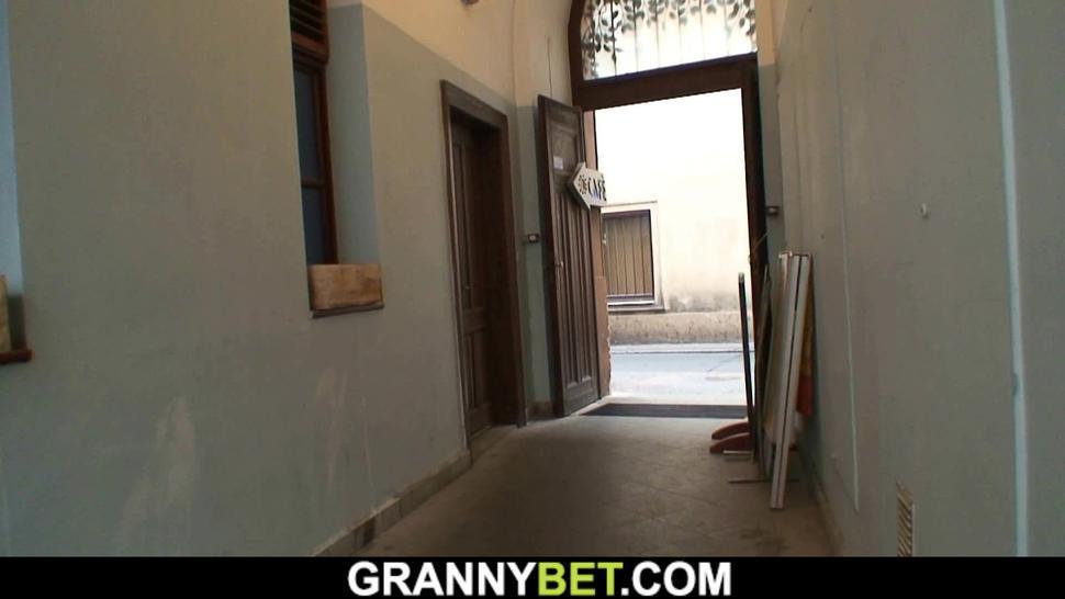 GRANNYBET - Big tits blonde granny pleases younger stranger