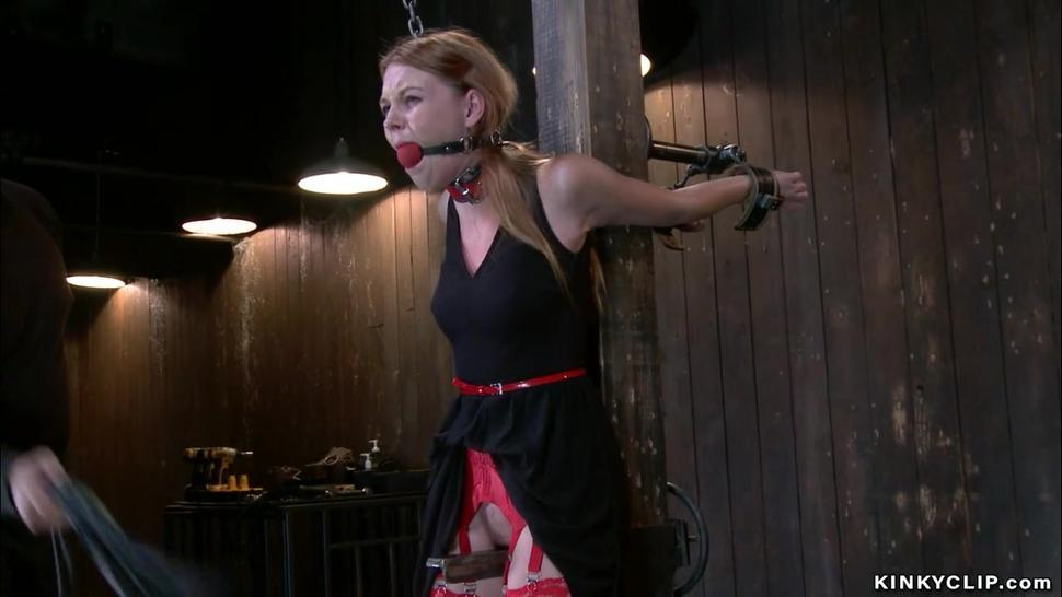 Gagged slave in red stockings whipped