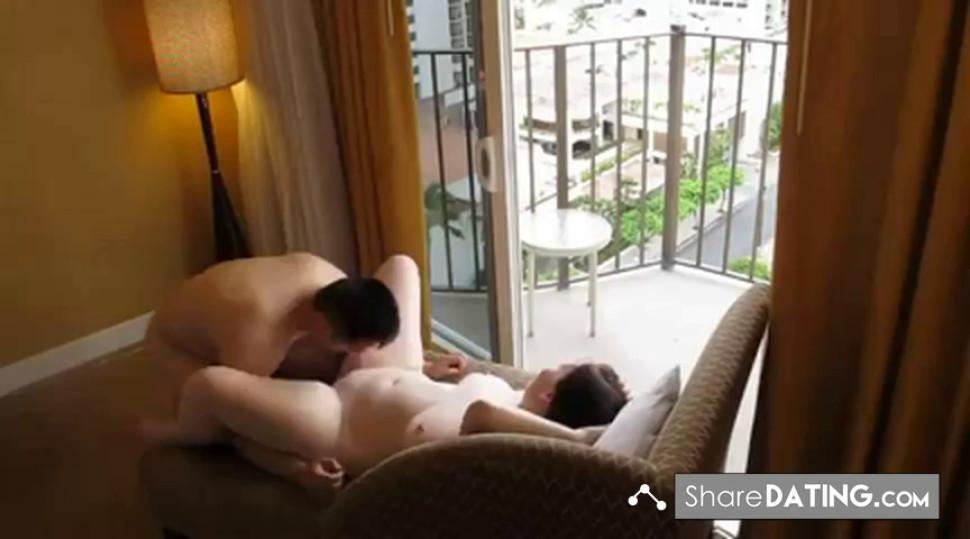 Asian Male and White Female fucking infront of the Balcony