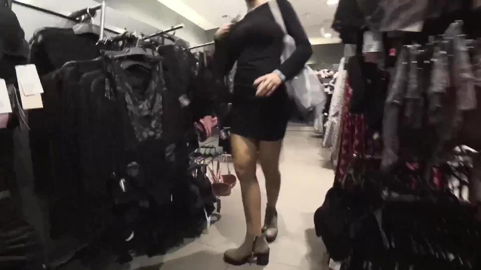 Sneaking sex in the public changing rooms of a clothing store