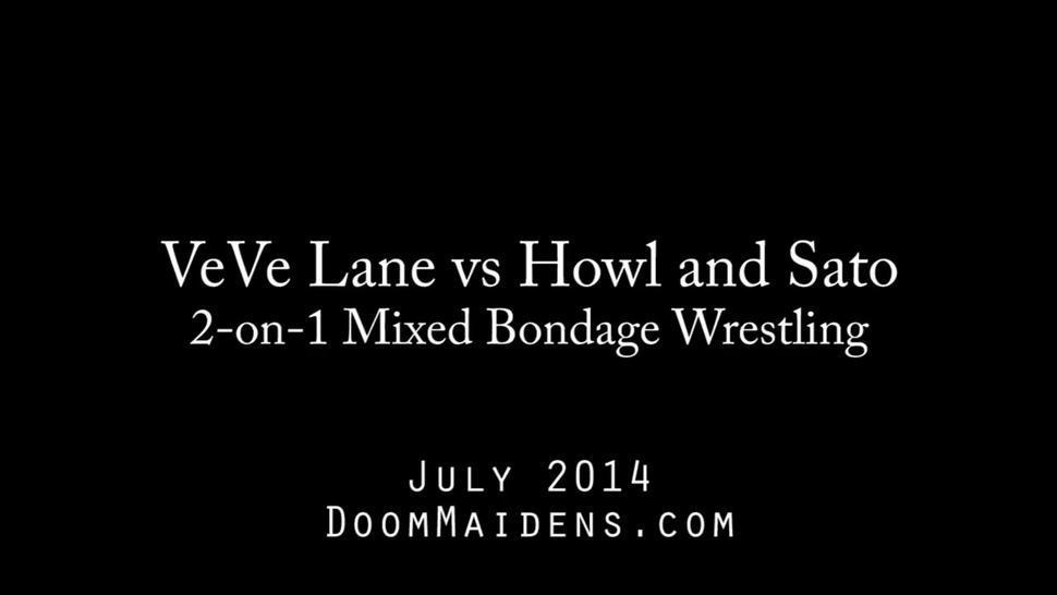 Bondage wrestling - one woman against two men