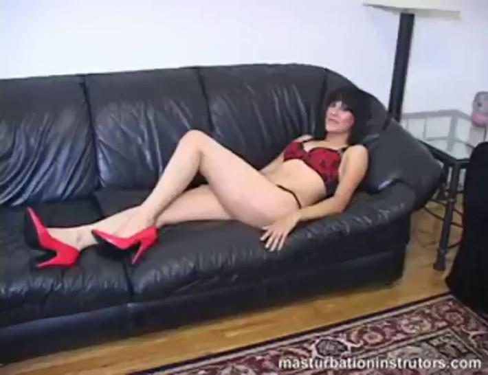 Cock teasing on the couch while in a sexy red bikini
