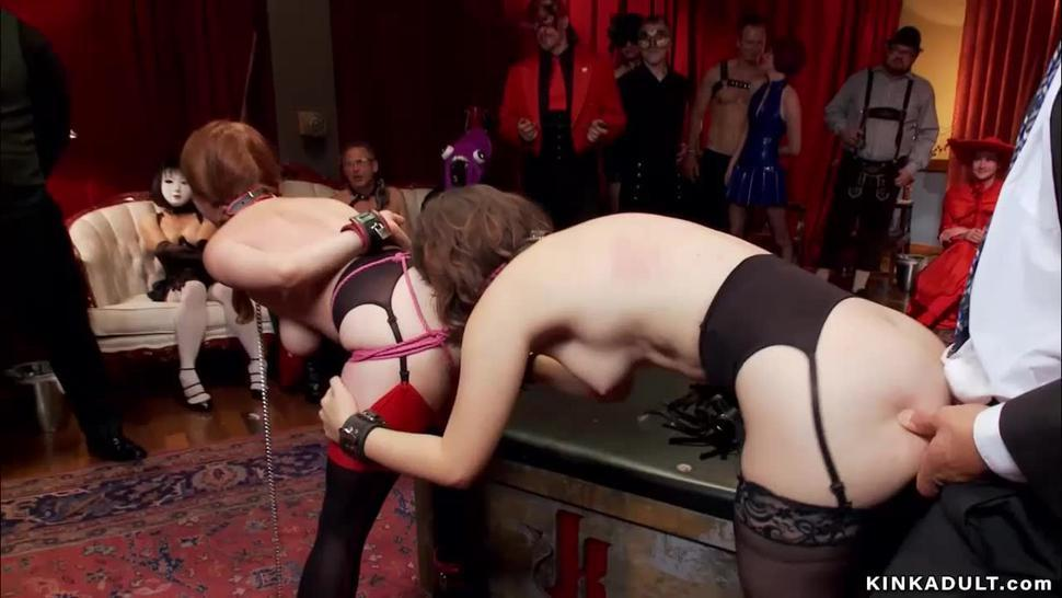 Two slaves get anal at bdsm orgy party
