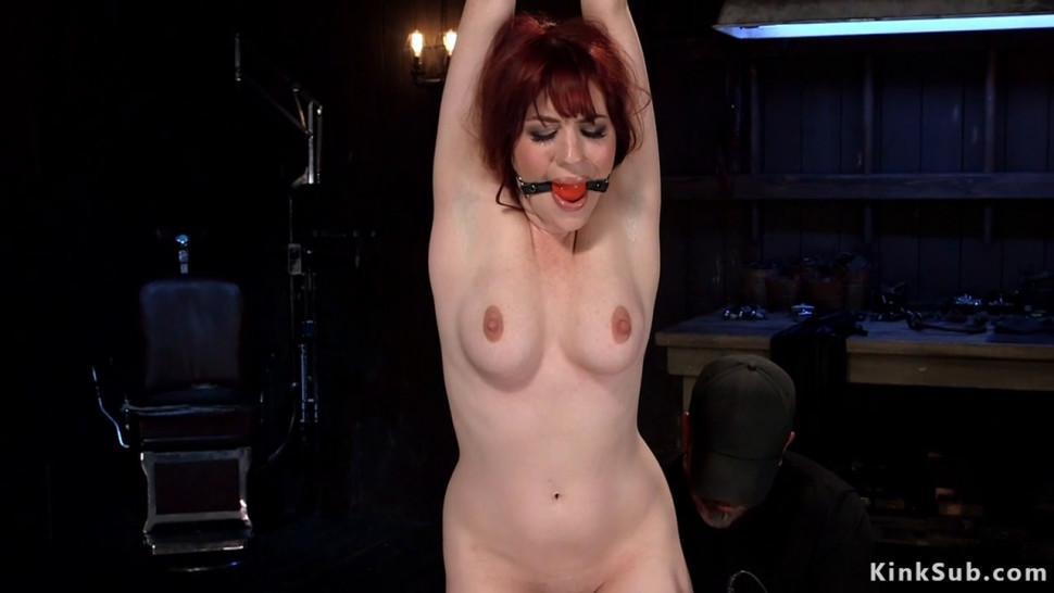 Redhead in extreme metal device bondage