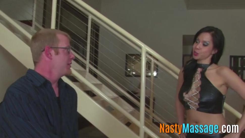 Asian babe gives a handjob with bondage involved