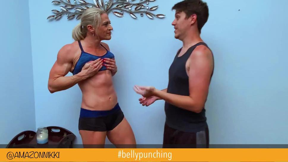 6ft ripped Amazon fbb takes belly punches from weakling fan! WOW!