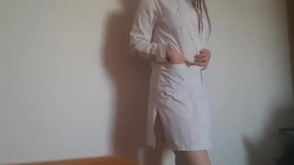 Young nurse mastrubation in white robe