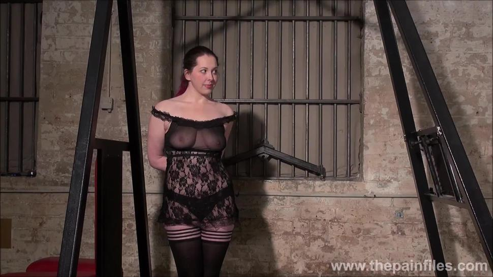 Lifestyle BDSM slave Alora Lux undressed and whipped in the dungeon by real life dominant master