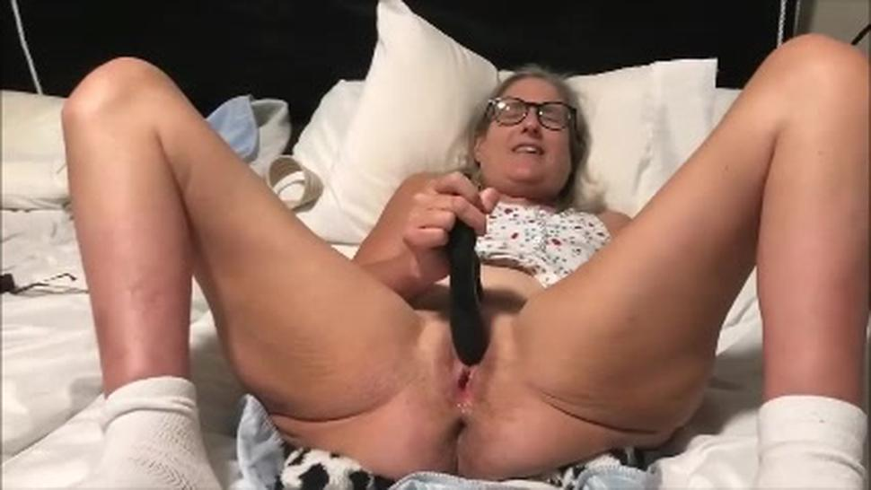 Older lady with glasses is masturbating with vibrator