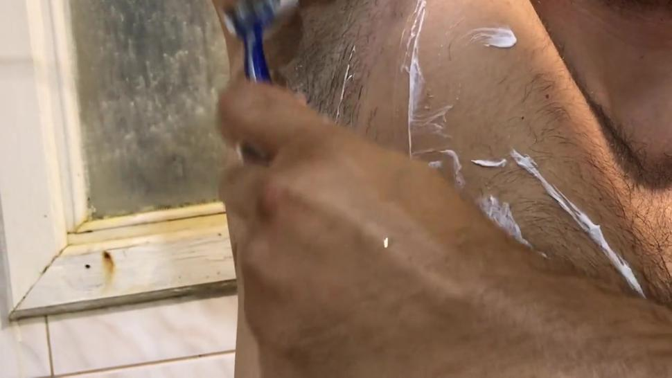 big guy in the shower washes himself
