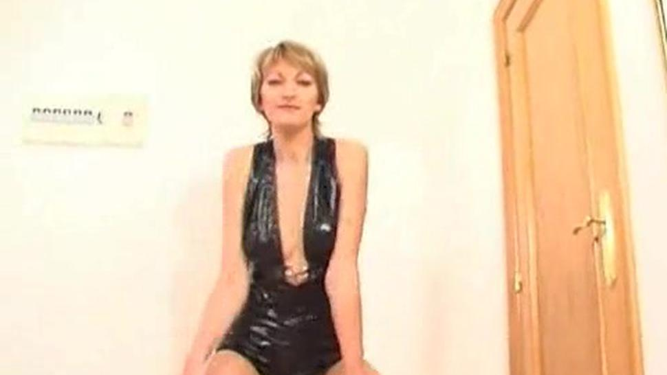 MILF Estelle In A Leather Outfit That Comes Off