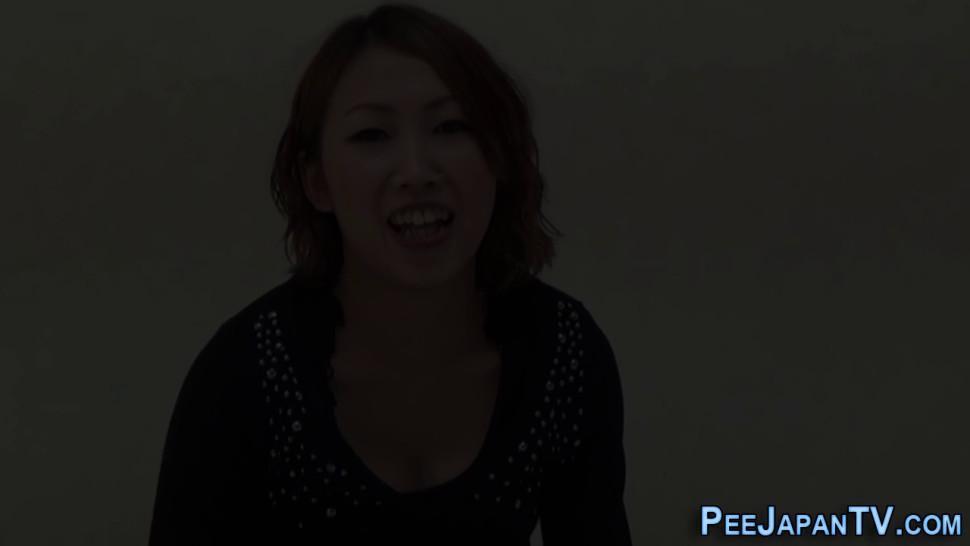 Kinky asian slut pees in public