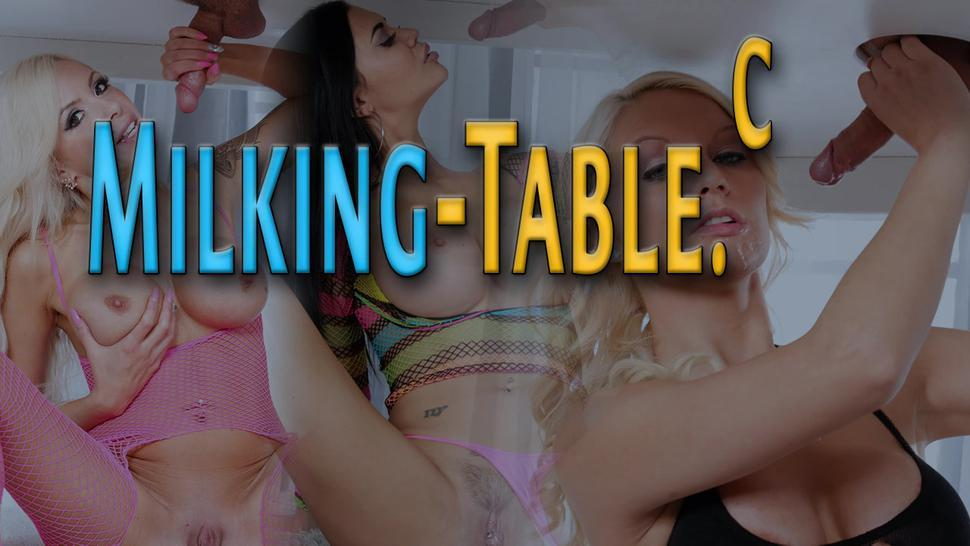 Blonde sex therapist under milking table