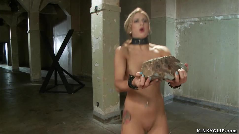 Blonde gets training with heavy rocks