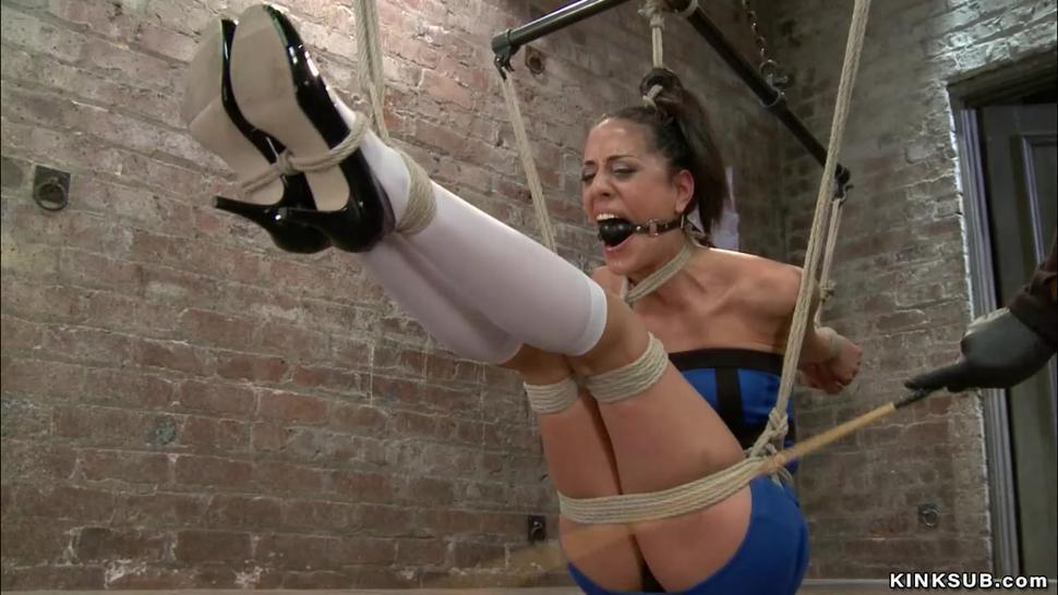 Skinny lesbian in back arch bondage