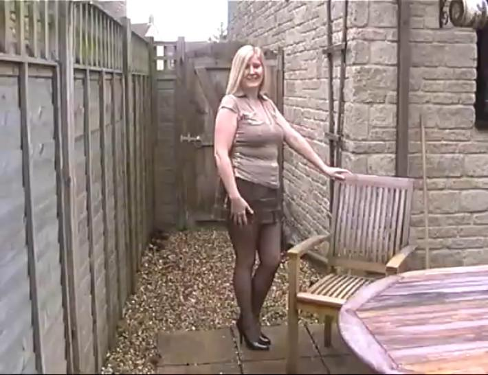 milf in black fully fashioned stockings exposing her big tits outdoors