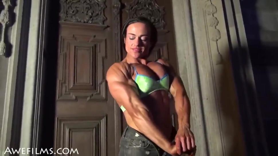 FBB flexing her muscles