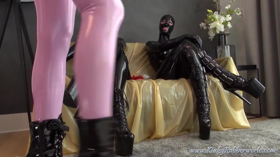 Latex lara in pink latex catsuit with 2 women in black latex catsuits