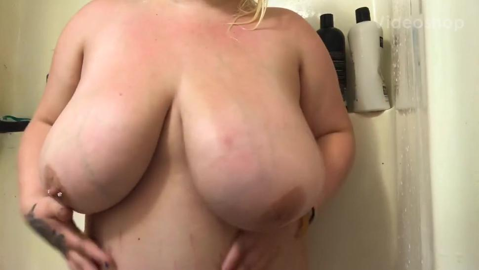 SHOWER TIME  playing with my massive boobs for a little
