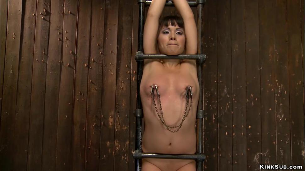 Waxed Asian slut in extreme bondage