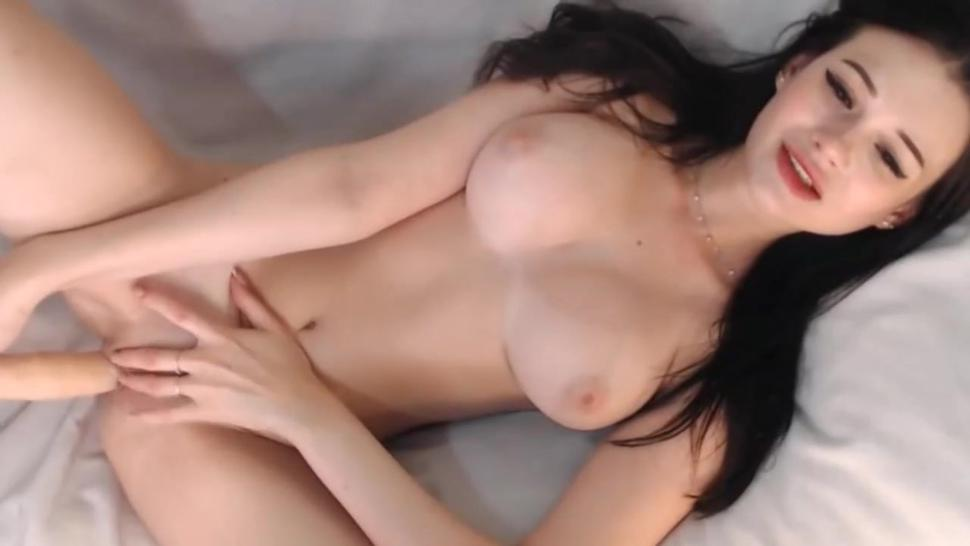 hot sexy woman with huge boobs masturbating