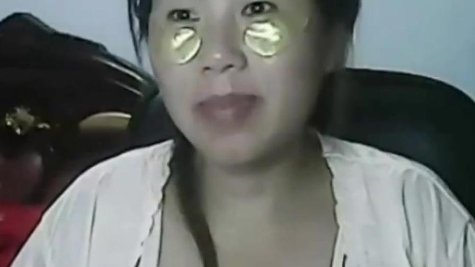 Wetting pussy of lonely Chinese MILF