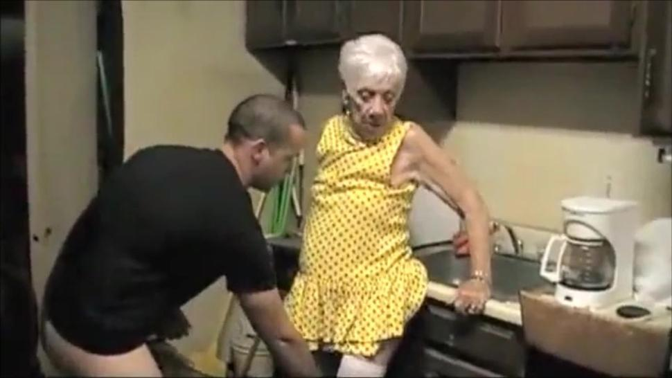 Very old grandma in lingerie get fucked by young boy in the kitchen