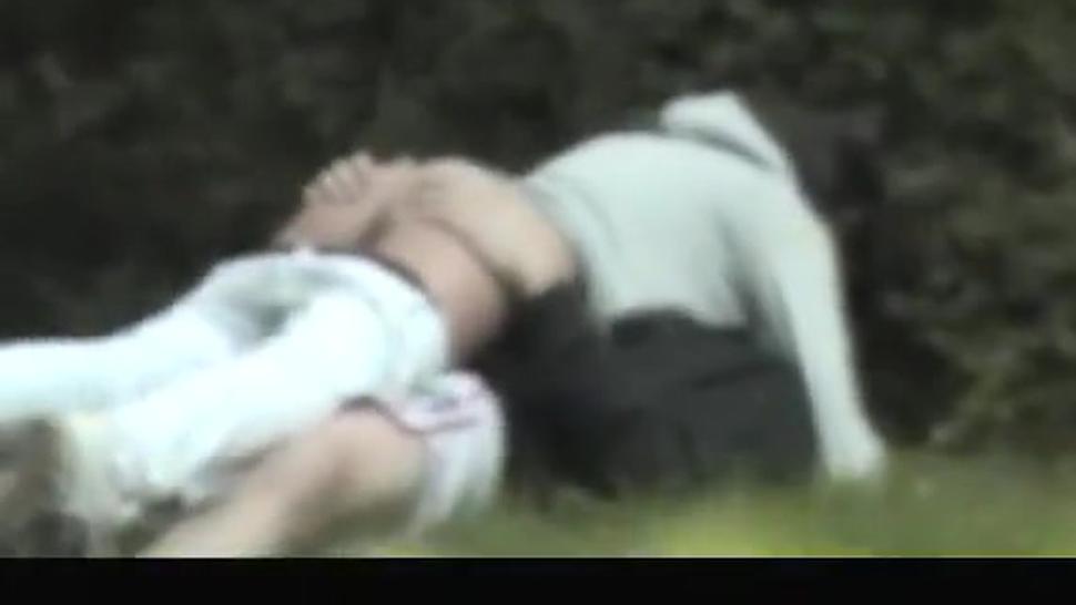Horny teen couple caught in public garden
