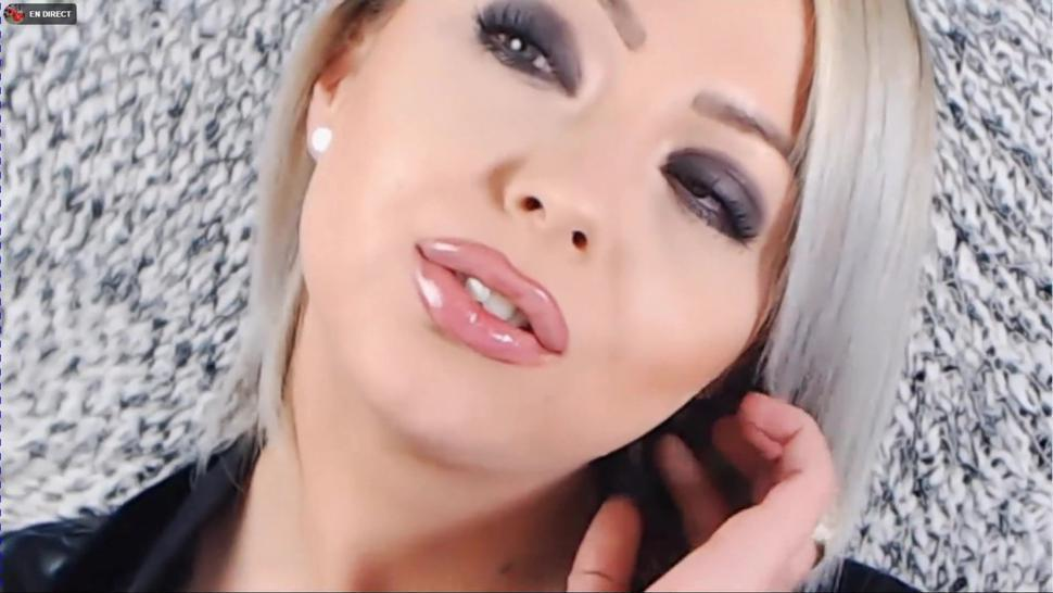 blonde mistress glossy lips tease and smoking in leather (face close up)