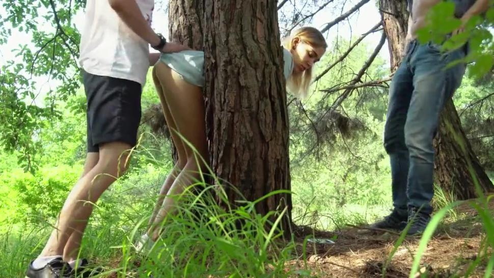 Two guys caught a blonde and fucked her in the woods