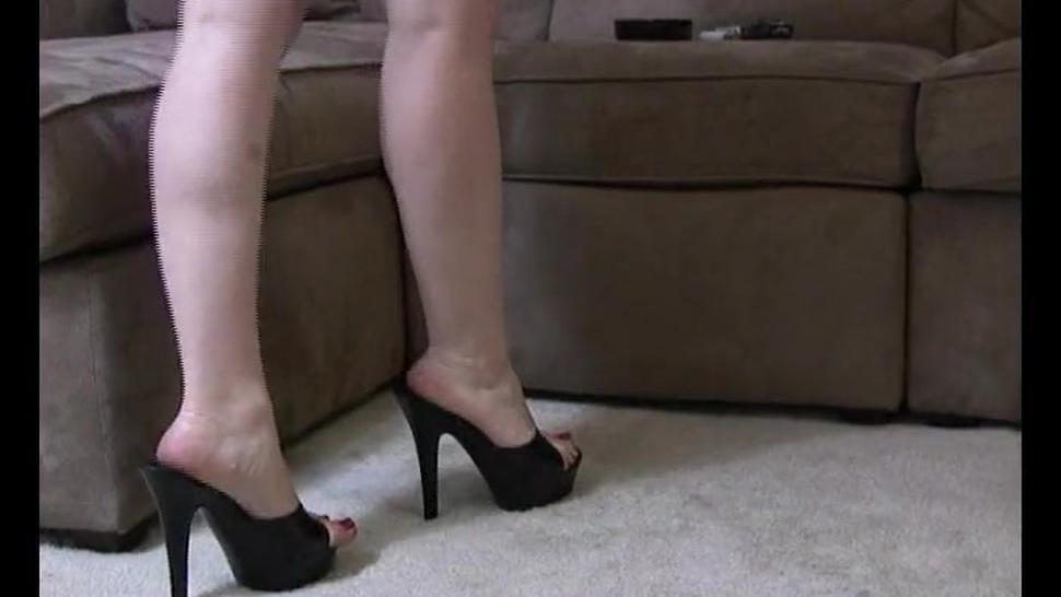 Secretary smoking in oficce on high heels