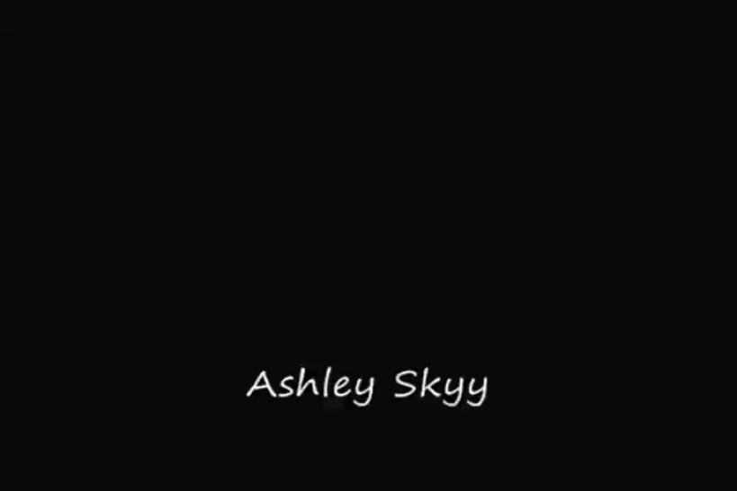 Ashley Skyy rubs lotion on her brea