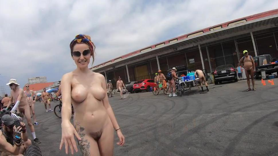 Bubbles Bikes and Breasts. Artist nude woman popping giant bubbles at the LA world naked bike ride