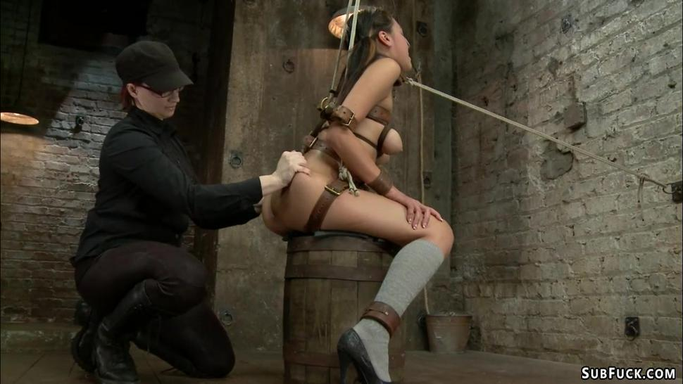 Hot lesbian is strapped and spanked