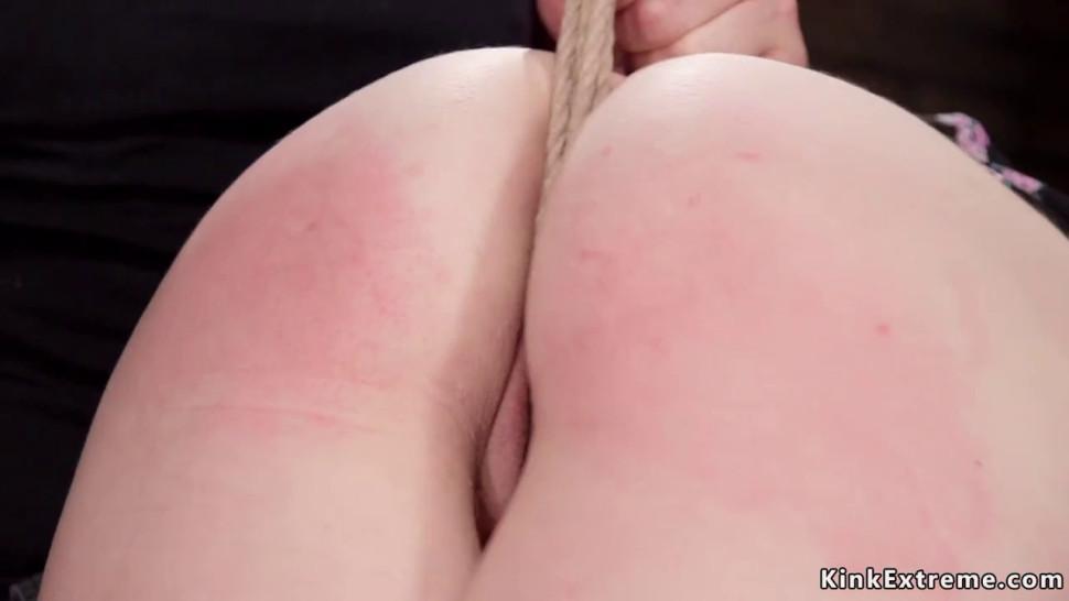 Slave in crotch rope bondage gets spanked