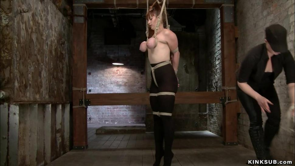 Redhead in tights hung for big tits