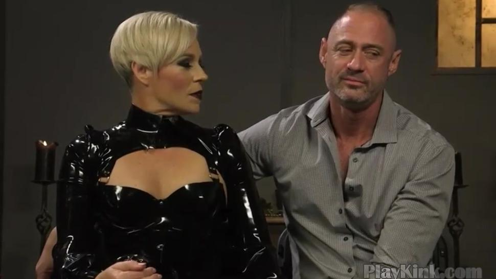 Blonde dominatrix playing with her slave