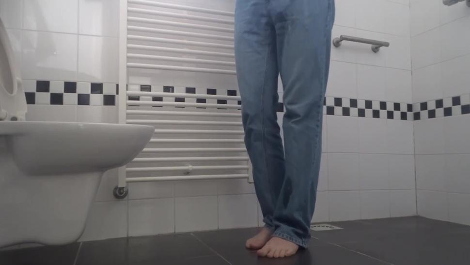 Desperate pee in bathroom, wetting pants and floor. End with cumshot