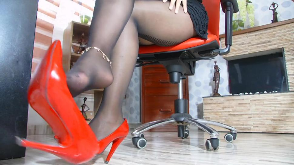 with my crossed legs covered in silky silk I let my beautiful red heel dangle