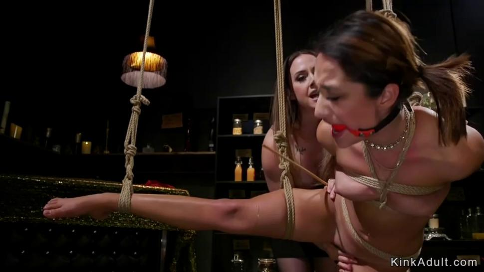 Busty mistress spanks and canes slave