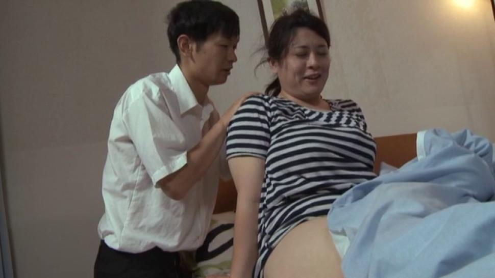 Vigorous japanese woman is posing for the camera and teasing
