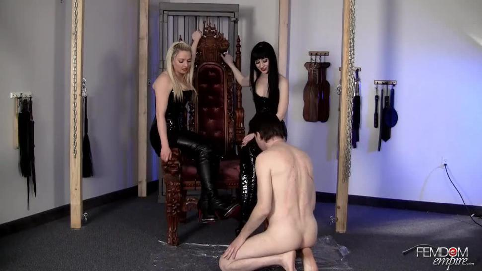 the slave fucks the two beatiful mistress boots and cum onto the nice boots licking them