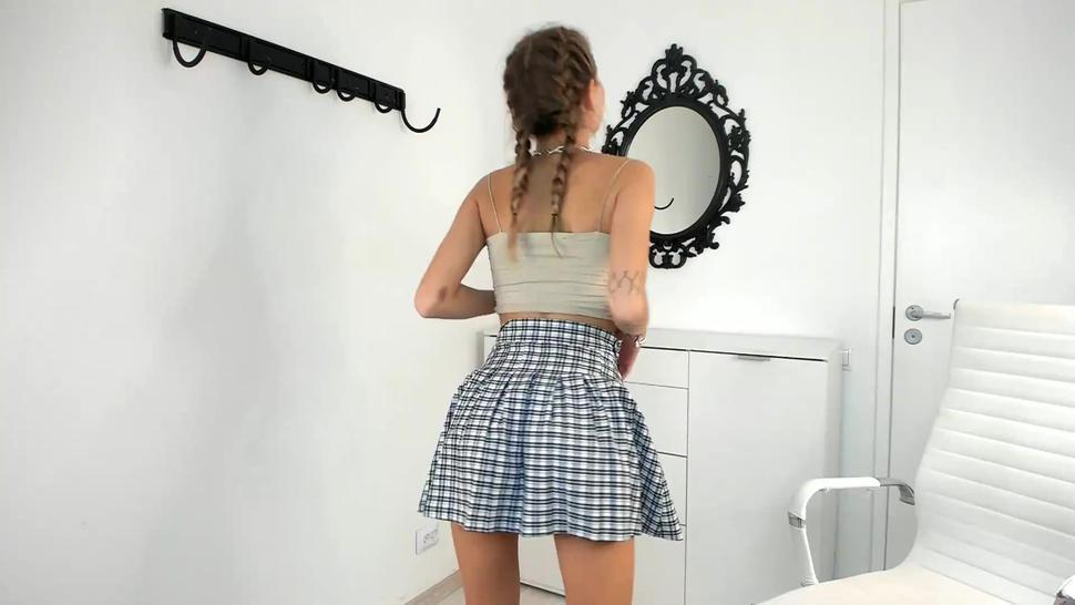 Teen with pigtails