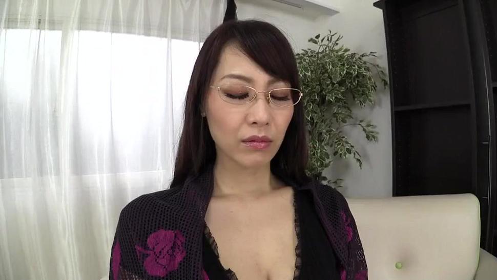 Mature Japanese woman teases and masturbates