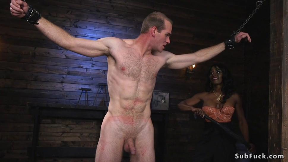 Busty ebony bodybuilder dominates man