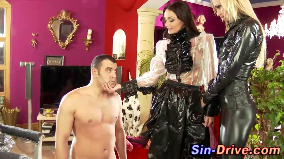 Clothed dominas tug dick