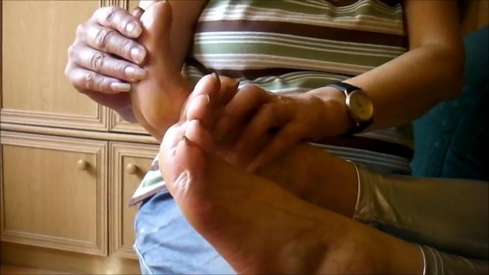 mature feet tickled by long nails